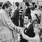 John Travolta, Olivia Newton-John, and Allan Carr in Grease (1978)