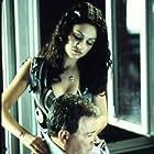 William Shatner and Mila Kunis in American Psycho II: All American Girl (2002)