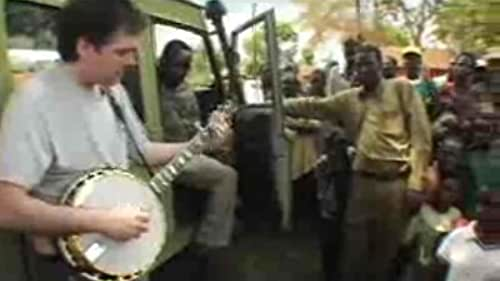 A film crew follows the well-known banjo player Bela Fleck on his travels to Africa, where he learns about the instrument's origins.
