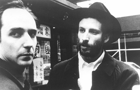 Renegade mathematician Max Cohen (Sean Gullette, left) and the leader of the Kabbalah sect, Lenny Meyer (Ben Shenkman) have a chance encounter on a Chinatown street corner.