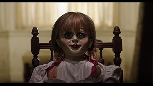 Several years after the tragic death of their little girl, a dollmaker and his wife welcome a nun and several girls from a shuttered orphanage into their home, soon becoming the target of the dollmaker's possessed creation, Annabelle.