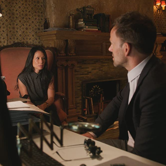 Jonny Lee Miller and Lucy Liu in Elementary (2012)
