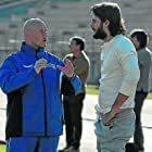 David Campbell giiving some instrucciones during a football training to Sergio Mur (Sócrates) in the film Shooting for Socrates