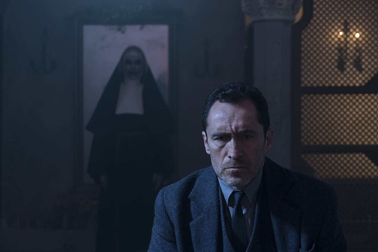 Bonnie Aarons and Demián Bichir in The Nun (2018)
