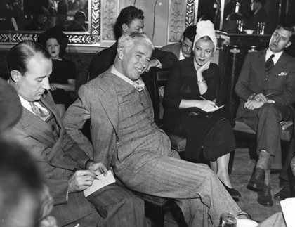 """Charlie Chaplin at a press conference for the premiere of """"The Great Dictator"""" Waldorf Astoria Hotel, New York City October 1940"""