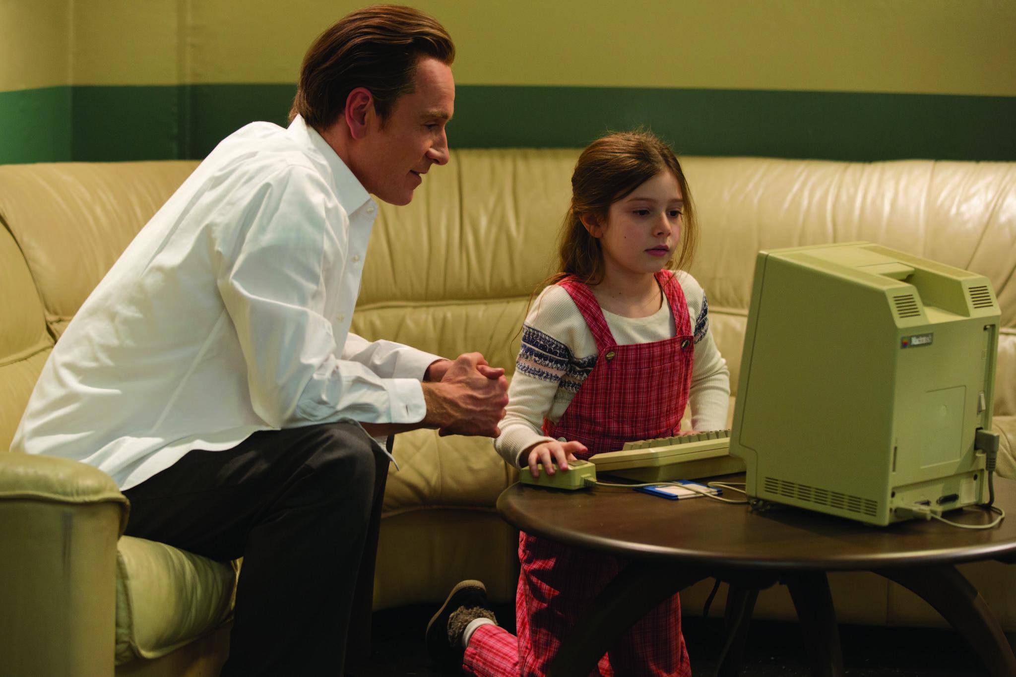 Michael Fassbender and Makenzie Moss in Steve Jobs (2015)