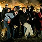 Some of the crew celebrate after they got a shot of a burning chicken coop.