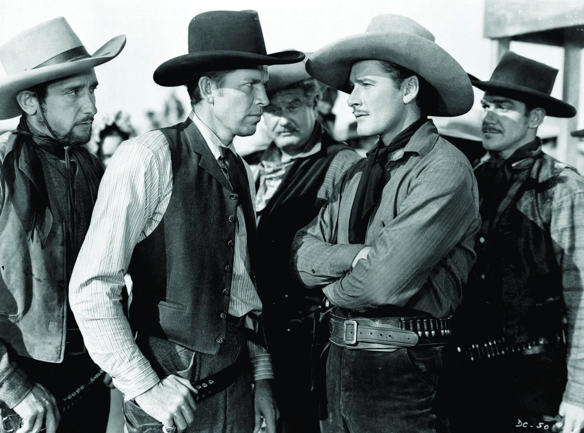 Errol Flynn, Alan Hale, Bruce Cabot, Douglas Fowley, and Victor Jory in Dodge City (1939)