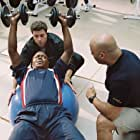 Stan Ross (Bernie Mac, lower left) hits the weight room with Boca (Michael Rispoli, upper left) and Brewers team conditioning coach (Scott Brooks, right) to prepare for his unlikely baseball comeback.