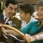 Rowan Atkinson, Emma de Caunes, and Maxim Baldry in Mr. Bean's Holiday (2007)