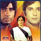 Amitabh Bachchan, Shashi Kapoor, and Nirupa Roy in Deewaar (1975)
