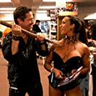 """Still photography of """"Blood + Kisses"""" promotion at the """"Fangoria Weekend of Horrors"""". Director Gregg Simpson holds a stake to Denise Masino's."""