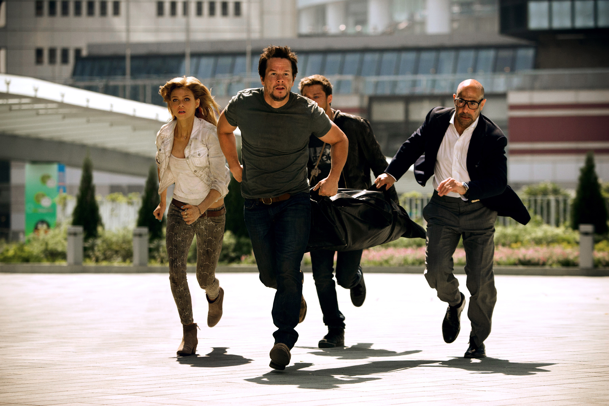 Mark Wahlberg, Stanley Tucci, Nicola Peltz, and Jack Reynor in Transformers: Age of Extinction (2014)