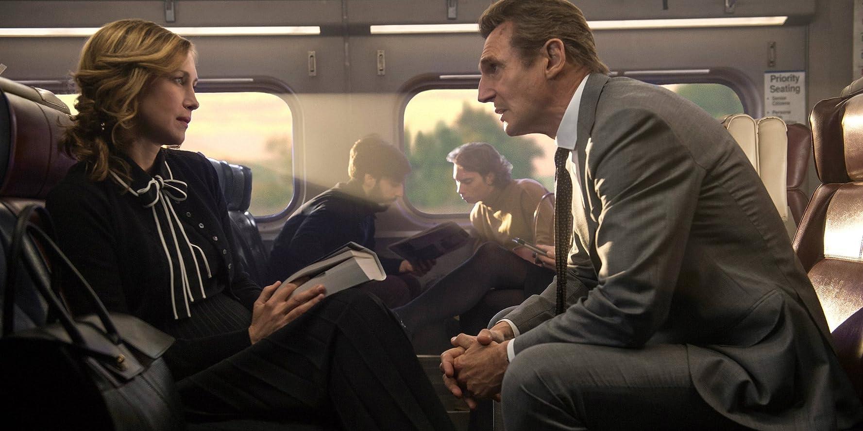 Liam Neeson and Vera Farmiga in The Commuter (2018)