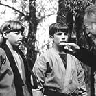 Mathew Botuchis, Michael O'Laskey II, James Paul Roeske II, and Victor Wong in 3 Ninjas: High Noon at Mega Mountain (1998)