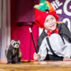 Still of Falcor the Ferret and Jacob Tremblay in The Magic Ferret.