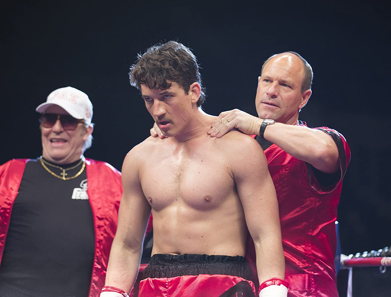 Aaron Eckhart, Ciarán Hinds, and Miles Teller in Bleed for This (2016)