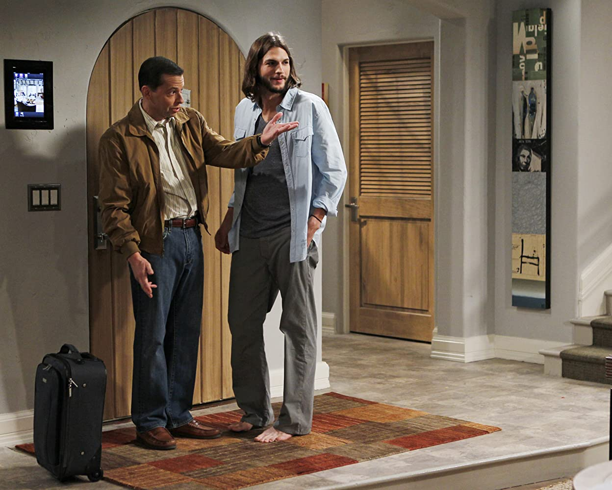 Jon Cryer and Ashton Kutcher in Two and a Half Men 2003