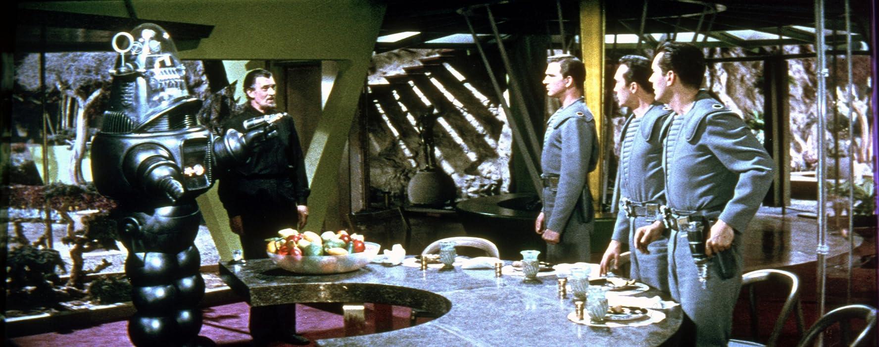 Leslie Nielsen, Jack Kelly, Walter Pidgeon, Warren Stevens, and Robby the Robot in Forbidden Planet (1956)