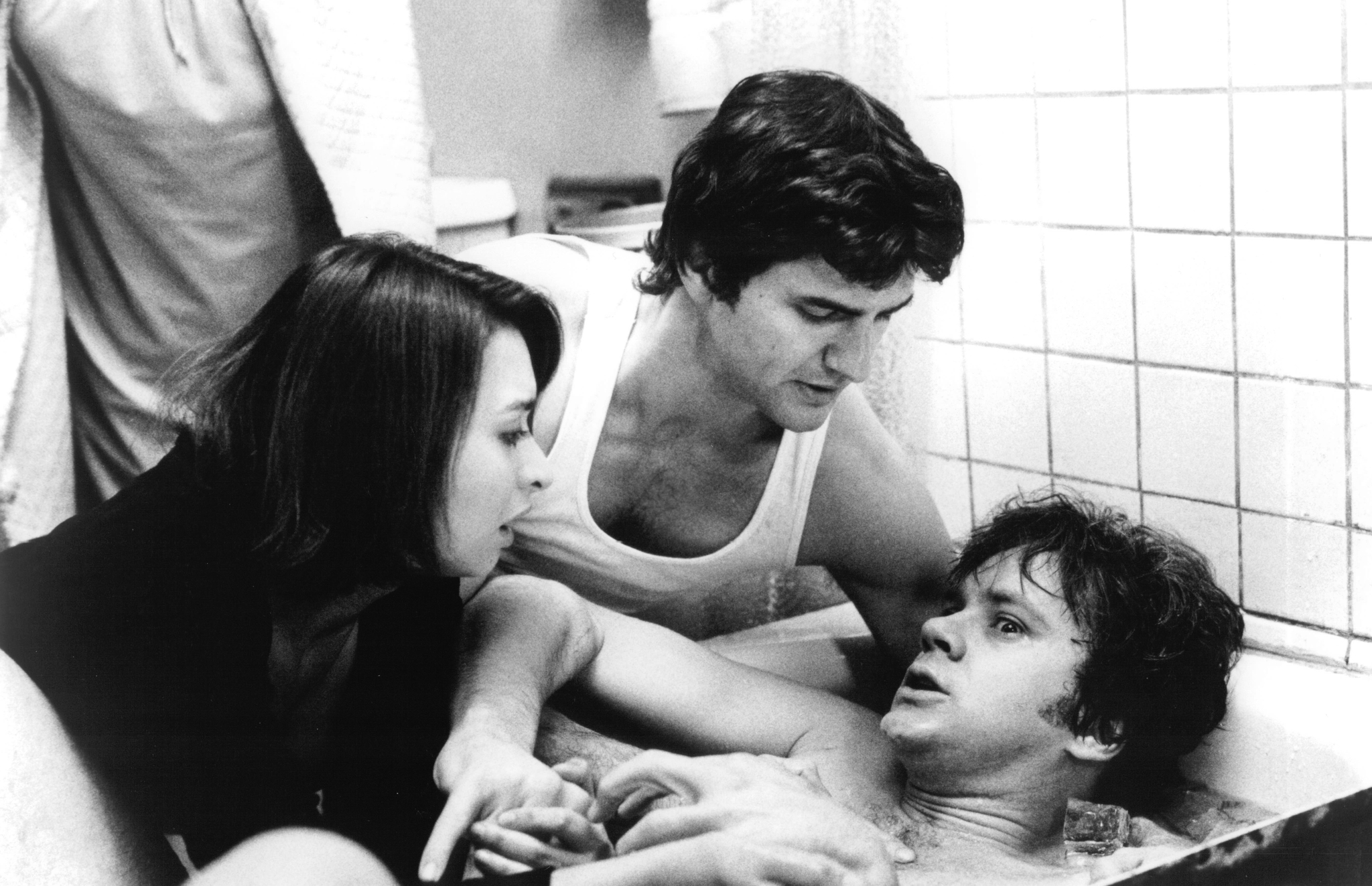 Tim Robbins, Elizabeth Peña, and Evan O'Meara in Jacob's Ladder (1990)