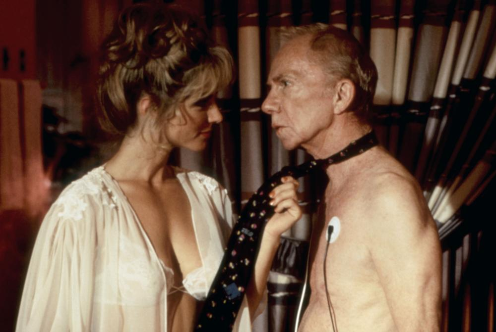 Ray Walston and Karen Lorre in Paramedics (1988)