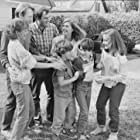 Mary Beth Hurt, Colleen Camp, Danny Corkill, Amy Linker, Michael McKean, Barret Oliver, and Steve Ryan in D.A.R.Y.L. (1985)