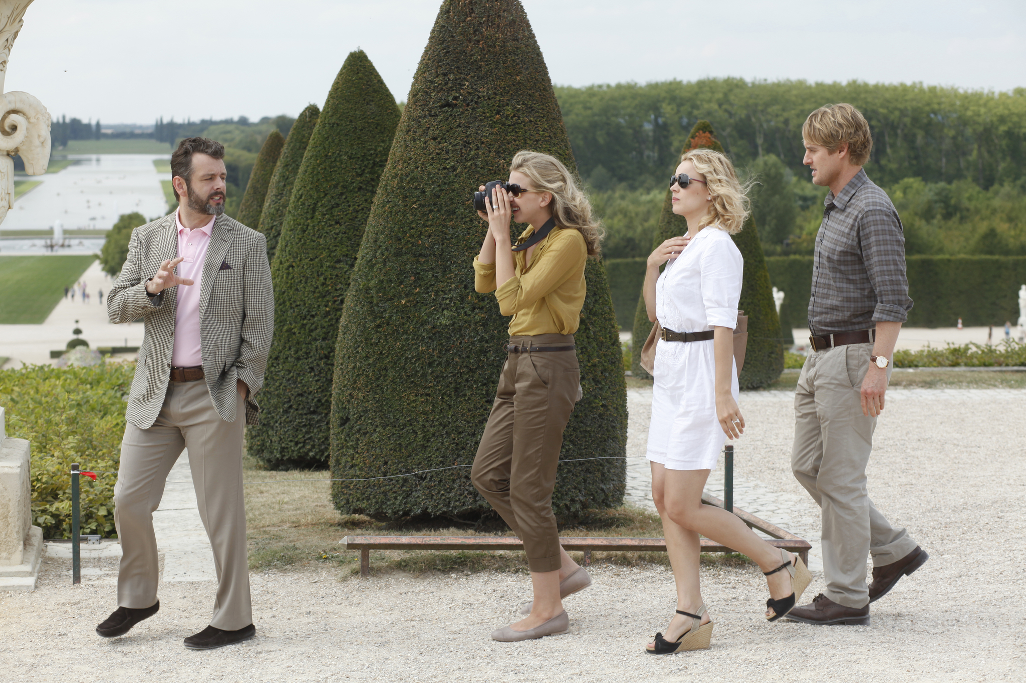 Owen Wilson, Michael Sheen, Rachel McAdams, and Nina Arianda in Midnight in Paris (2011)