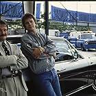 Tim Robbins and Robin Williams in Cadillac Man (1990)