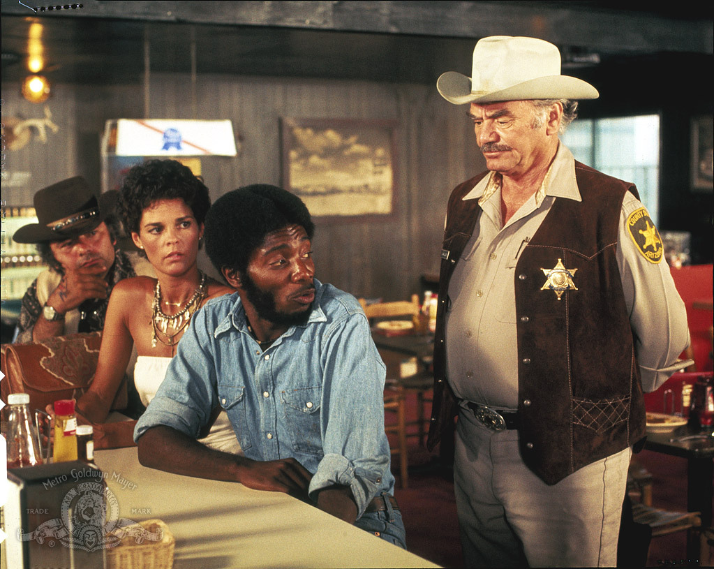 Ernest Borgnine, Franklyn Ajaye, Ali MacGraw, and Burt Young in Convoy (1978)