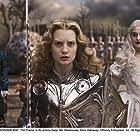 Johnny Depp, Anne Hathaway, and Mia Wasikowska in Alice in Wonderland (2010)