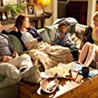 Stanley Tucci, Patricia Clarkson, Emma Stone, and Bryce Clyde Jenkins in Easy A (2010)