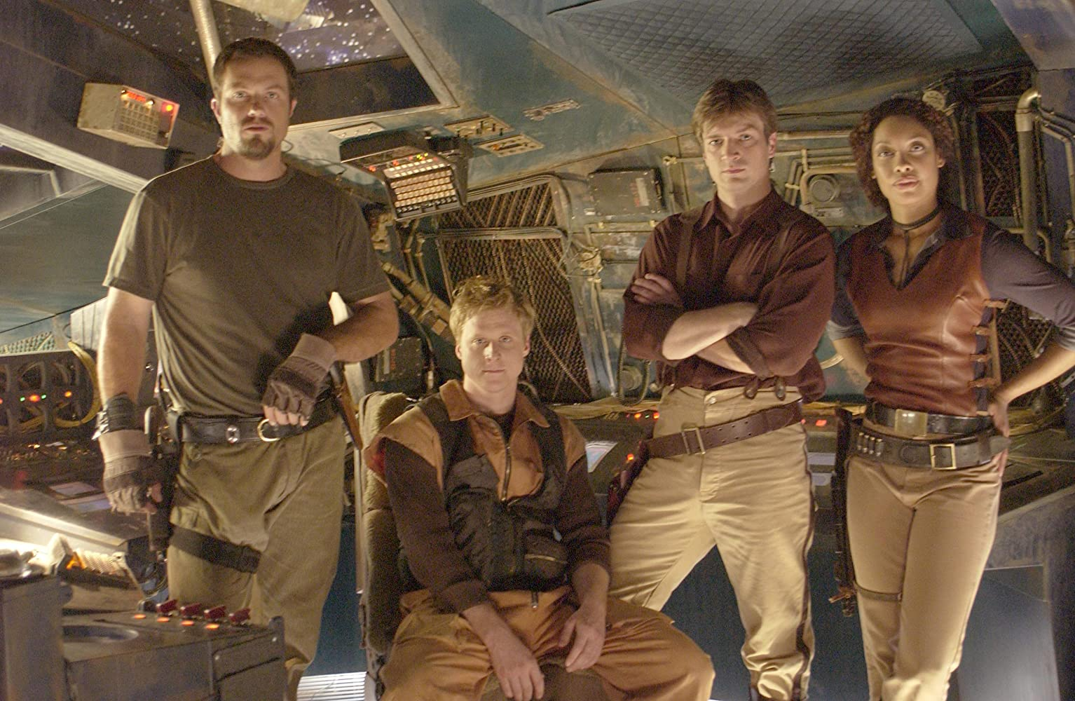 Adam Baldwin, Nathan Fillion, Gina Torres, and Alan Tudyk in Firefly (2002)