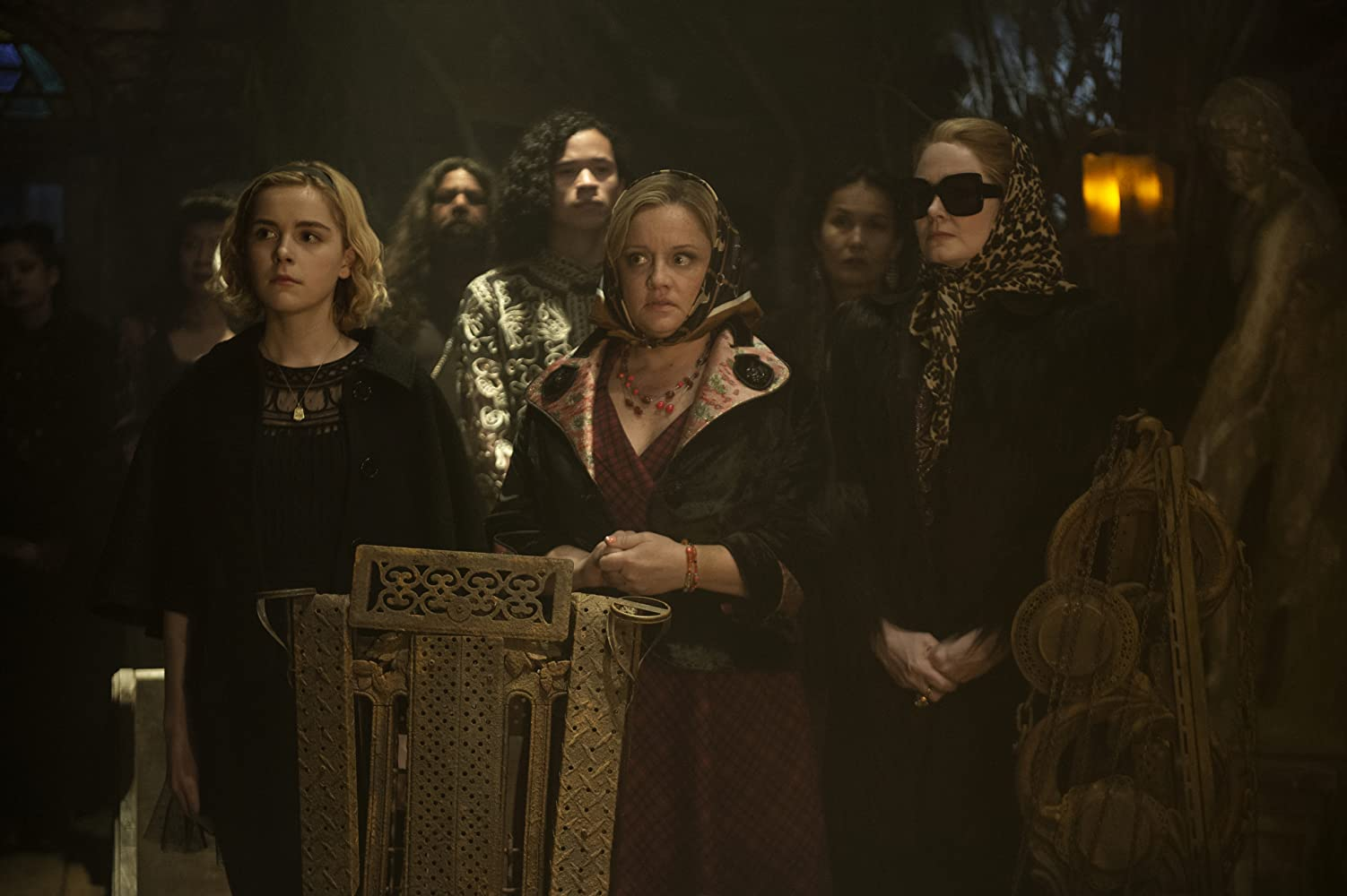 Miranda Otto, Lucy Davis, and Kiernan Shipka in Chilling Adventures of Sabrina (2018)