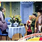 Groucho Marx, Chico Marx, Harpo Marx, and Esther Muir in A Day at the Races (1937)