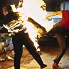 Wellman Anthony Santee (Dolph Lundgren) high-kicks a blazing henchman (Andy Armstrong) because that's the kind of guy he is, in Joshua Tree.