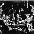 Lew Ayres, Ben Alexander, G. Pat Collins, Scott Kolk, Slim Summerville, Louis Wolheim, and John Wray in All Quiet on the Western Front (1930)