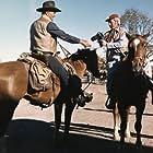 "John Wayne and photographer David Sutton on the set of ""Chisum"""