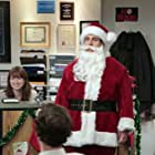 Steve Carell, John Krasinski, and Ellie Kemper in The Office (2005)
