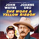 John Wayne and Joanne Dru in She Wore a Yellow Ribbon (1949)