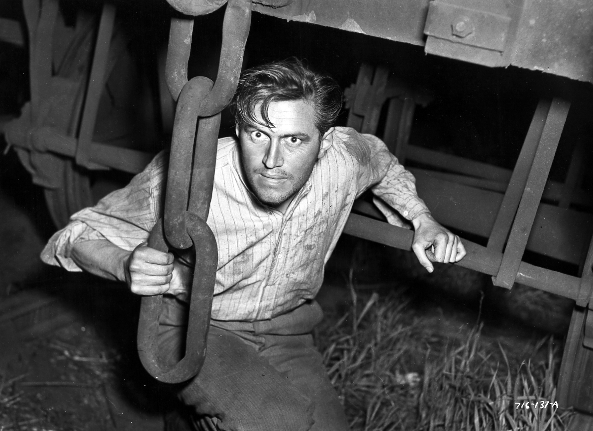 John McCallum in It Always Rains on Sunday (1947)