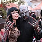 """Carrie Keagan and Jack Bennett on the set of """"Fetish Factory"""""""