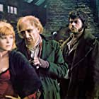 Oliver Reed, Ron Moody, and Shani Wallis in Oliver! (1968)