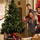 From L to R : Mason Cook (Will Vancamp), John Brotherton (Dave Gabriel), Izabela Vidovic (Ally Vancamp) and Summer Glau (Christine Prancer) decorate  a big Christmas three with  old family ornaments and lights.
