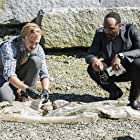 Tom Felton and Jesse L. Martin in The Flash (2014)