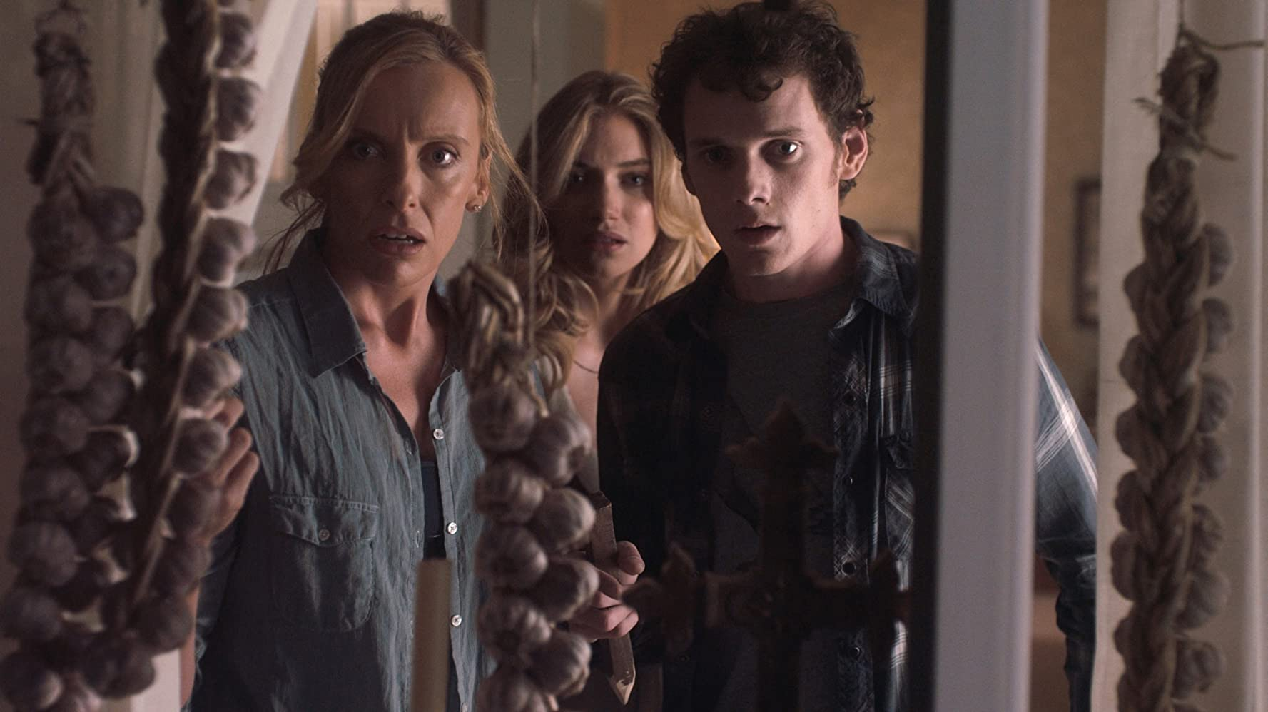 Toni Collette, Anton Yelchin, and Imogen Poots in Fright Night (2011)