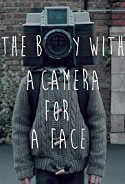 The Boy with a Camera for a Face Poster