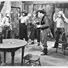 Gene Alsace, Buck Bucko, Roy Bucko, Ed Carey, Tracy Layne, Lew Meehan, and Marion Shilling in Gun Smoke (1935)
