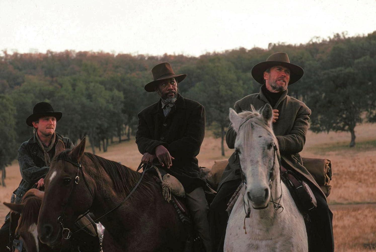 Clint Eastwood, Morgan Freeman, and Jaimz Woolvett in Unforgiven (1992)