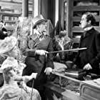 Alec Guinness, Dennis Price, and Anne Valery in Kind Hearts and Coronets (1949)