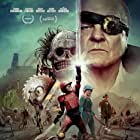 Michael Ironside, Laurence Leboeuf, and Munro Chambers in Turbo Kid (2015)